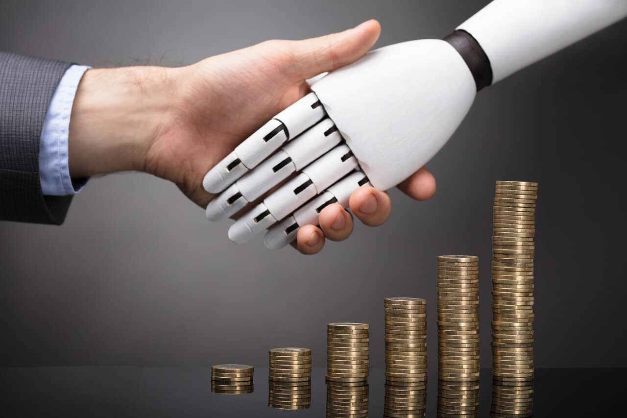 Businessperson And Robo investment shaking hands